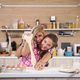 Teenage girl and young mother feeling good while cooking - PhotoDune Item for Sale