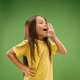 Isolated on blue young casual teen girl shouting at studio - PhotoDune Item for Sale