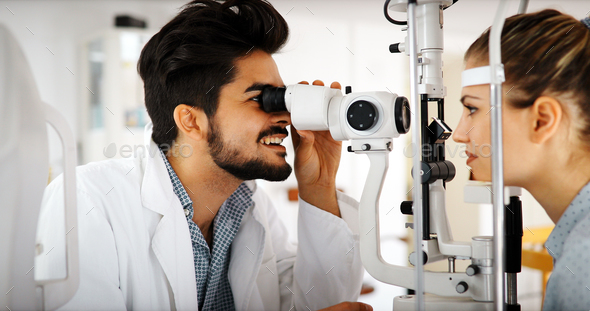 optometrist checking patient eyesight and vision correction - Stock Photo - Images