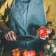 Woman cooking tomato sauce or pasta at kitchen counter - PhotoDune Item for Sale