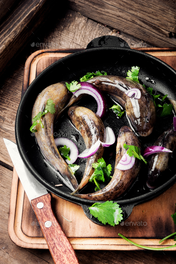 Frying pan with tasty fish - Stock Photo - Images