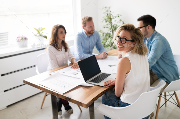 Group of young business people and architects working on project - Stock Photo - Images