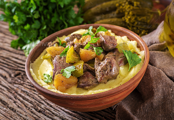Fried chicken liver with apples, sweet pepper and onions with mashed potatoes - Stock Photo - Images