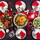The Christmas table is served with a turkey, decorated with bright tinsel and candles - PhotoDune Item for Sale