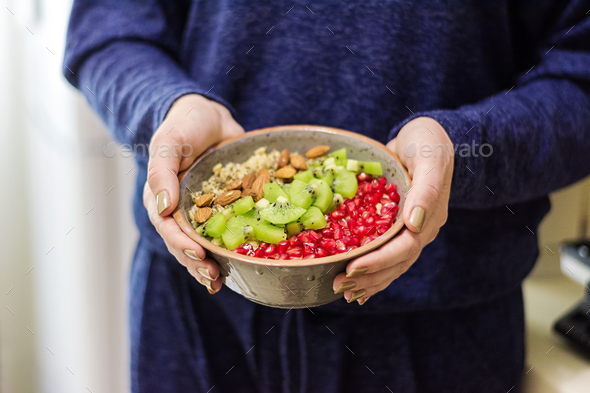 Fitness and healthy lifestyle concept. Female eating a healthy oatmeal after a workout. - Stock Photo - Images
