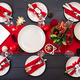 Prepared Christmas table for serving dishes. Scenery, spruce branches, tinsel and candles. Top view - PhotoDune Item for Sale