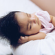 Baby girl sleeping in mother's arms - PhotoDune Item for Sale