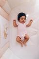 Baby is sleeping on bed. - PhotoDune Item for Sale