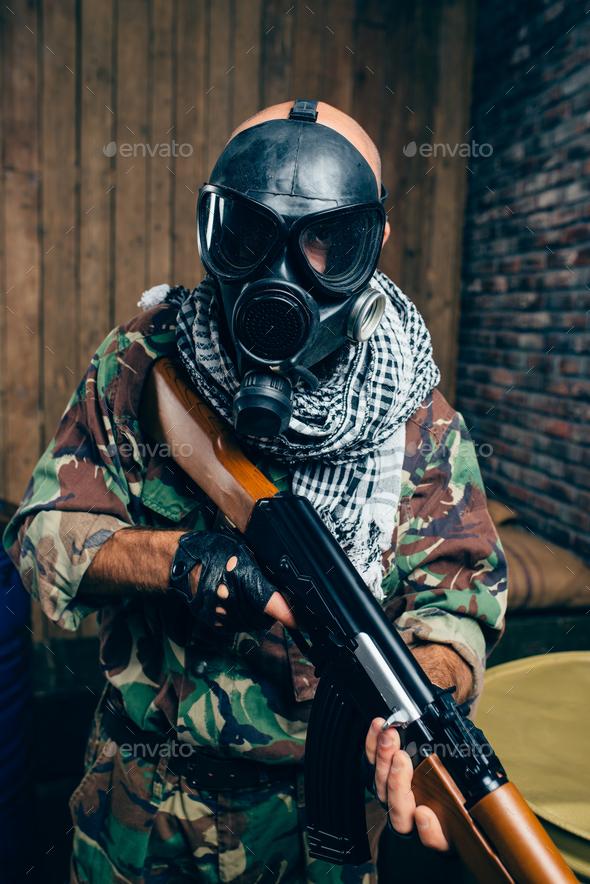 Terrorist in gas mask with kalashnikov rifle - Stock Photo - Images