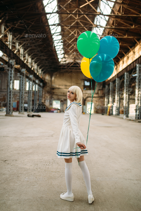 Anime style blonde lady with colorful air balloons - Stock Photo - Images