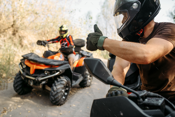 ATV rider showing thumbs up to his partner - Stock Photo - Images