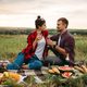 Love couple drinks wine, picnic in summer field - PhotoDune Item for Sale