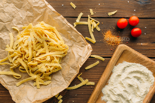 Uncooked pasta on wooden table closeup, nobody - Stock Photo - Images