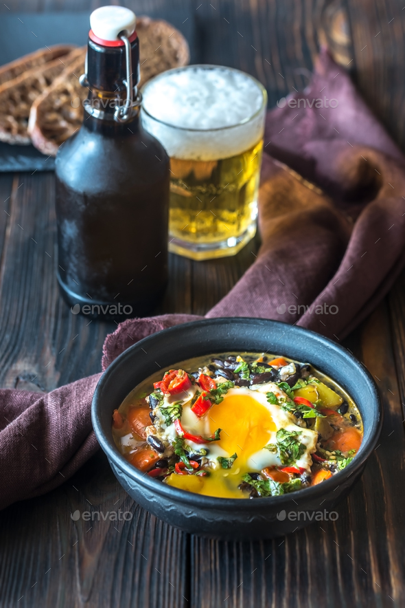 Soup of black beans and an egg - Stock Photo - Images