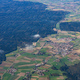 Agricultural fields and houses from above. Aerial view out of an airplane window. - PhotoDune Item for Sale