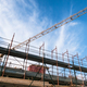 Lifting crane and building in construction site - PhotoDune Item for Sale