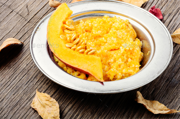 Pumpkin porridge and pumpkins - Stock Photo - Images
