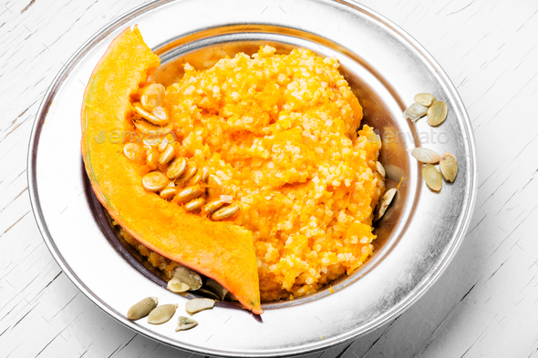 Pumpkin porridge and pumpkins - Stock Photo - Images
