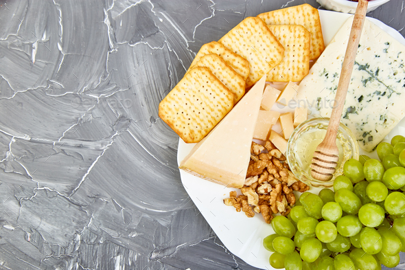 Cheese plate variety, and wine in glasses - Stock Photo - Images