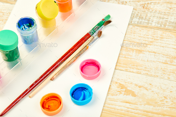 Watercolor palettes and paint brushes. Artist workplace - Stock Photo - Images