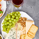 Cheese plate variety, and wine in glasses - PhotoDune Item for Sale