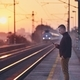Man waiting at railroad station - PhotoDune Item for Sale
