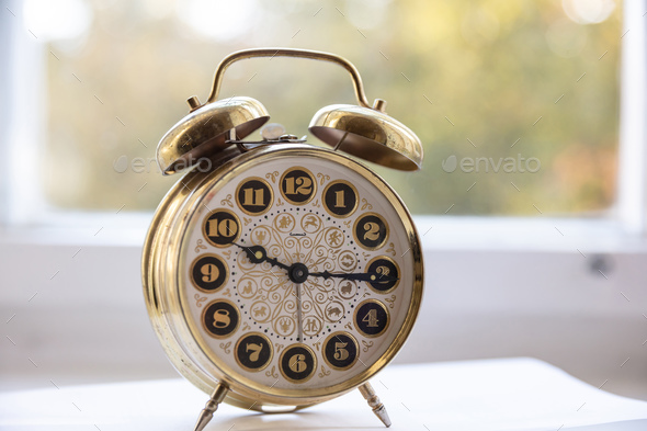 Alarm clock, morning time, blur glass window background - Stock Photo - Images