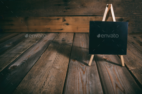 Blackboard on dark wooden background, copy space - Stock Photo - Images