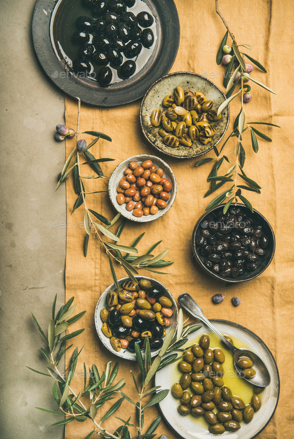 Mediterranean pickled olives and olive tree branches, top view - Stock Photo - Images