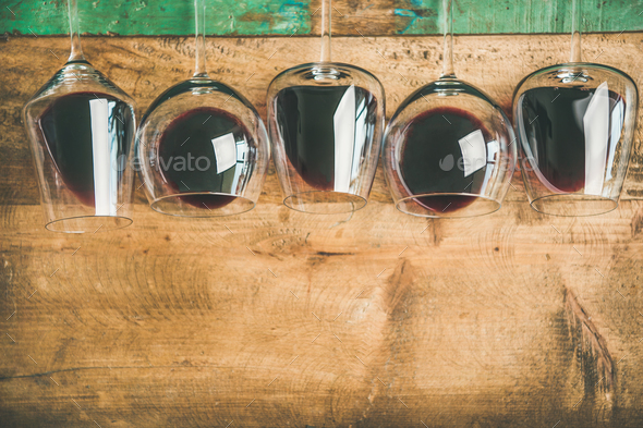Red wine in glasses over rustic wooden background, copy space - Stock Photo - Images