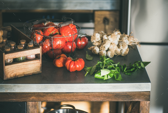 Kitchen counter with ingredients for cooking tomato sauce or pasta - Stock Photo - Images