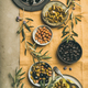 Mediterranean pickled olives and olive tree branches, top view - PhotoDune Item for Sale