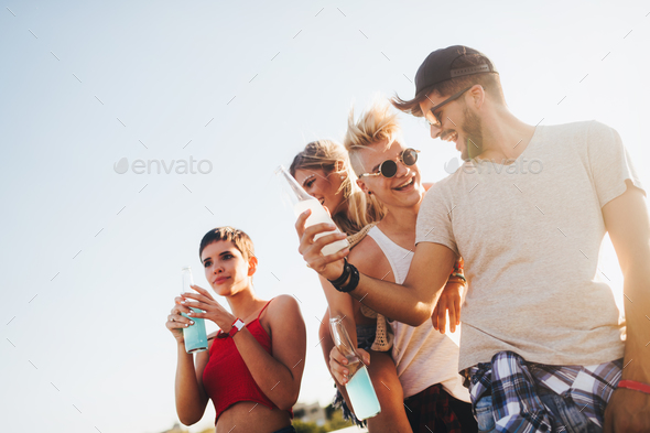 Group of young happy friends having fun time