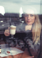 Dreamy girl with latte in cafe - PhotoDune Item for Sale