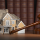 House with gavel and law books.  Real estate law and house aucti - PhotoDune Item for Sale