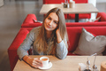 Young woman drinking tea in a cafe - PhotoDune Item for Sale