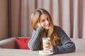Young beautiful woman drinking latte in cafe - PhotoDune Item for Sale