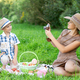 Little boy and teen age girl having picnic outdoors - PhotoDune Item for Sale