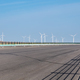 empty highway on wilderness and clean energy of wind power background - PhotoDune Item for Sale