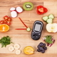Glucometer for checking sugar level and fruits with vegetables in shape of clock - PhotoDune Item for Sale