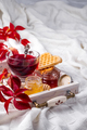 autumn fall concept with knitted blanket and hot tea with waffer, jam, honey on wooden tray on te - PhotoDune Item for Sale