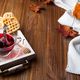autumn fall concept with knitted blanket and hot tea with waffer, jam, honey on wooden tray on - PhotoDune Item for Sale