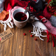 autumn fall concept with knitted blanket and hot tea with berries, autumn leaf on dark wooden - PhotoDune Item for Sale