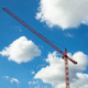 Red tower crane on blue sky background - PhotoDune Item for Sale