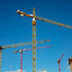 Construction site.Tower cranes on blue sky background - PhotoDune Item for Sale