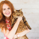 Young redhead woman with cat in arms. - PhotoDune Item for Sale