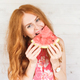 Red-hair woman is tasting a slice of watermelon - PhotoDune Item for Sale