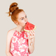 Joyful young woman holding slice of watermelon - PhotoDune Item for Sale