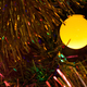Closeup of yellow Christmas tree lamp - PhotoDune Item for Sale
