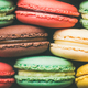 Colorful French macaroons cookies stacked in rows, wide composition - PhotoDune Item for Sale
